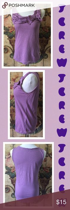 J crew purple floral tank top Summer sale price is firm unless bundled. Made by j crew this is a cotton tank top jazzed up. It's an extra small and it's purple. Has ruffles and a bow. Great with a skirt or jeans J. Crew Tops Tank Tops