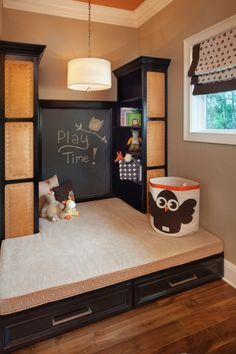 Cute play area.  Could do a pin board on the sides instead for extra room to display art.