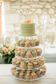 These cupcakes just look so delicious! Photo by  Lyn Ismael.  Get the Just Married cake bunting here - http://www.weddingfavorsunlimited.com/just_married_cake_bunting.html