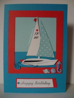 Sailing themed card with wire & seaside charms and key primary colours for effect