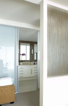 Reed glass as transom to let light into a windowless bathroom
