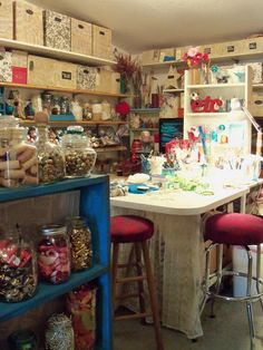 Fabulously cluttered Craft Studio....like the neutral boxes with splash of color with supplies