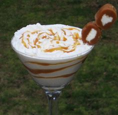 Caramel Cream Martini***** 2 oz. Baileys Caramel Liqueur** 1 oz. Vanilla Vodka** 1 oz. Creme de Cacao (dark)** 2 oz. Half & Half**Combine the spirits and Half & Half into an ice filled cocktail shaker.  Cover and shake well.  Drizzle some of the Caramel Topping along the inside of a chilled Martini glass.  Strain your drink into the glass.