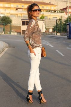 Brown graphic loose top with white skinny jeans n black leather heels
