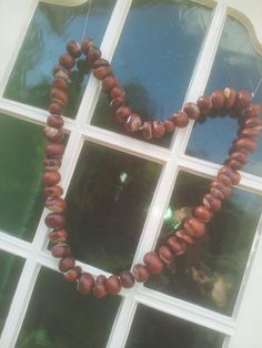 Kastanje hart met de kids gemaakt voor aan de voordeur!
