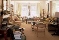 Everything I love - lots of light, comfy seating and books piled everywhere!  Bunny Williams NY apt.