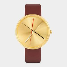 Crossover Watch Modeled after the game of pick-up sticks, this fetching watch displays the time in a way that is as curious as it is captivating. The slender hands tick around a gilded brass dial in a graphic and unconventional way to indicate the passage of time. Hidden lugs connect the supple leather band seamlessly to the stainless steel face. Water-resistant. Steel case with IP brass-tone plating with a brown calf leather strap. Buy it online at www.momastore.com