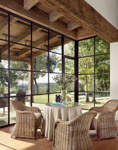Mediterranean home with inviting design style in Austin - Pergola Ideas Steel Windows, Windows And Doors, Iron Windows, Black Windows, Ceiling Windows, Porch With Windows, Wall Of Windows, Corner Windows, Sunroom Windows