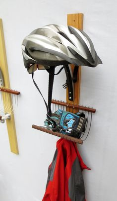 Bicycle Gear Rack from Reclaimed Wood and Recycled Bicycle Parts. Clever way to keep your helmet safe and gear organized.