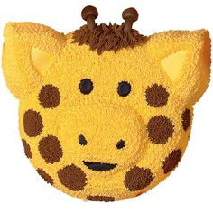 Giraffe Cake  - This adorable guy will draw plenty of rubbernecking attention. Create the handsome head using an Animal Crackers Pan cake, piped-icing details and chocolate nougat candy rolls horns.