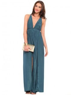 Flowy, teal maxi dress featuring a plunging neckline and an open back with a self tie strap