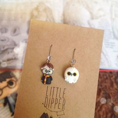 Harry potter and Hedwig earrings. Earrings are completely handmade out of polymer clay.Each one is sculpted by hand, using no molds. Size (Harry) : approx. 1.5 cm in height x 0.9 cm in wide Size (owl) : approx. 1 cm in height x 1 cm in wide **It can be made as a brooch or an