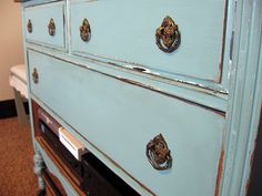 Dresser reinvented into a shabby distressed turquoise media unit. So pretty!