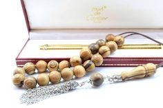 Olive Wood Komboloi Worry Beads Greek Komboloi Metal Tassel Olive Wood Beads Stress Relief Gift for Him Made in Greece Father's Gift. Follow @alterdeco.eu for awesome Handcrafted Accessories. You can get 10% OFF with the discount code INSTA10. Link is in the bio @alterdeco.eu  #komboloi #begleri #worrybeads #stressrelief #greekkomboloi #greece #greeks #greekbegleri #greekworrybeads #greekbeads #madeingreece #greekgift #birthdaygift #giftformen #giftfordad #fathergift #boyfriendgift Greek Gifts, Yoga For Stress Relief, Greeks, Gifts For Father, Boyfriend Gifts, Tassel, Birthday Gifts, Beaded Bracelets, Beads