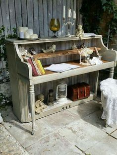 """Two shelves up top, the upper shelf tilted down at the front with a lip to hold the top keyboard. The bottom shelf to store the pedals. Make the side panels, walls and top out of 1"""" pine."""