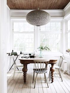 neutral organic weathered dining room with tons of texture