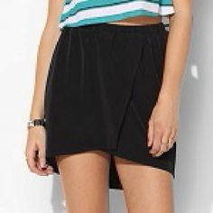 Urban Outfitters Bycorpus silky black mini skirt Silky notchfront skirt with side pockets. NWOT. Very versatile, can wear year-round.  **Also selling matching striped top in medium** Urban Outfitters Skirts Mini