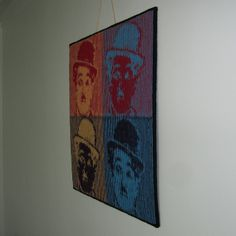 Ravelry: Charlie à la Warhol pattern by Steve Plummer Wall-hanging  An illusion knit inspired by Andy Warhol's screen prints. Four colours of yarn are used to create a wall-hanging that looks like four striped squares when you look from directly in front. When you look from the side four faces are revealed, each in a different colour. http://www.ravelry.com/patterns/library/charlie-a-la-warhol