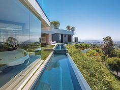 PART ONE: Modern Mansion With Wrap Around Pool and Glass-Walled Garage For $36 Million. (36 Pics) - if it's hip, it's here