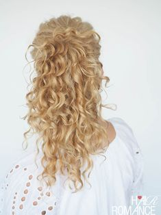 This trick pony really makes your hair look longer!  Check out Hair Romance's 30 Days of Curly Hairstyles ebook at http://www.hairromance.com to learn how to master your curls every day with ease.