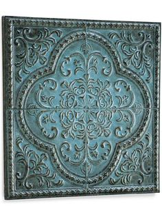 Inspired by the embossed tin tiles that adorn the ceilings of historic buildings, these color-rich tiles are a delightful addition to any space. Hang one above the mantel, another in the foyer, or add one to a wall in the kitchen.