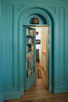 A bookshelf doubles as a beautiful arched secret library door in a Maine country home....