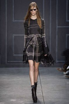 Well placed plaid on the skirt and open patterned plaid in the bodice make a silky flowy little dress something to make note of from Vera Wang this Fall. Styled just right.
