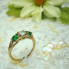 #Perfect for a #spring #engagement!  #Traditional yellow gold with #diamond and #emerald.  A classic style that will remain timeless for years to come!