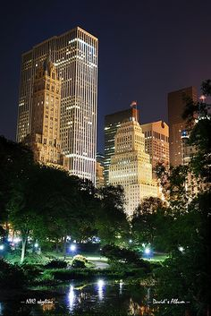 New York City Central Park at night with Manhattan skyscrapers lit with light NYC