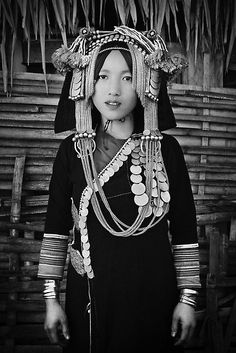 Laos, Phongsali Province, Papuon Mai village, Akha hill tribe, lady with traditional headdress. | © Glen Allison