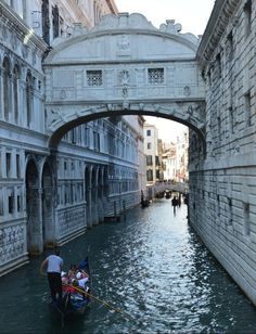 """Ponte dei Sospiri (Bridge of Sighs), in Venice, Italy. The Baroque bridge that spans the Rio di Palazzo hasdark origins. The bridge was constructed of white limestone in the early 1600s to connect the inquisitors inside Doge's Palace to the prison across the river. The structure was called the Bridge of Sighs because the view of Venice through the grilled windows of the enclosed overpass was thought to be the last glimpse of the outside world convicted prisoners saw before they were execute..."