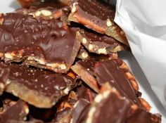 Salted Caramel Pretzel Bark- We used dark chocolate chips and bought an extra bag (1 bag for 3 batches) to make it a little easier to spread. Tip: Use salt liberally. Some will come off when you break it in pieces.
