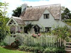 English style cottage with picket fence