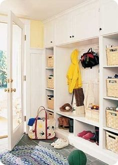 Nice built-in shelves for mudroom... w/ Ikea kitchen cabinets this could actually be affordable... to ponder.