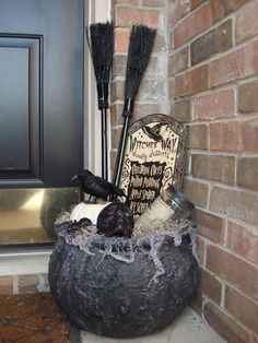 Halloween decorations - Dollar Store Halloween Front Porch Decor with witch's cauldron, brooms, crows.