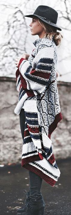 How to wear a poncho, long printed cardigan, black skinny jeans, lace-up boots, and a fedora for fall. Shop the pin...