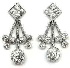 Pair of early century diamond cluster drop earrings by Cartier, Paris workshop maker's mark for G. Art Deco Earrings, Art Deco Jewelry, Vintage Earrings, Fine Jewelry, Drop Earrings, Edwardian Jewelry, Antique Jewelry, Vintage Jewelry, Art Nouveau