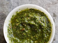 How to make pesto: : Blend 8 cups packed basil leaves, 1 cup olive oil, 1/2 cup toasted pine nuts, 2 to 4 garlic cloves and 1/2 teaspoon salt in a food processor until almost smooth. Stir in 1/2 cup grated parmesan cheese. via Food Network