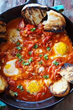 Piperade, a specialty from the French Basque Country, is pretty similar to shakshuka. Just simmer some onions, garlic, tomato sauce, peppers, and spices. Crack a few eggs and serve. Pro tip: pierce the yolk as soon as you serve and mix it with the sauce, it won't look as good but it'll taste even better. Get the recipe here.