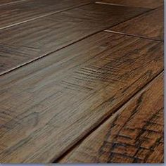 """Easy Maintenance: Jasper Engineered Hardwood-Hand scraped collection Hickory Charlotte.  Dimensions 1/2"""" X 5"""" x RL. Finish includes seven coats of Treffert aluminum oxide. It is a tongue and groove system. This item has a 25 year finish and structural warranty. Its Janka Hardness is 980 and it has a recommended waste factor of 5-10%."""