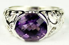 SR123, Amethyst, East-West 925 Sterling Silver Ring * Stone Type - Amethyst * Approximate Stone Size - 12x10mm  * Approximate Stone Weight - 6 cts  * Jewelry Metal - Solid 925 Sterling Silver * Approximate Metal Weight - 4.2 grams  * Ring Size - Size selectable during checkout * Our Warranty - A full year on workmanship  * Our Guarantee - Totally unconditional 30 day guarantee