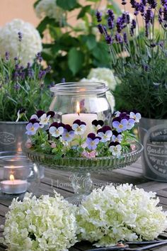Violets & a Candle on a Crystal Cake Plate for an Easy, Pretty Centerpiece home flowers garden candle decorate centerpiece violet
