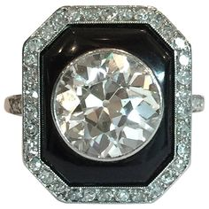 Our Favorite Vintage Engagement Rings - large round cut diamond in black onyx engagement ring