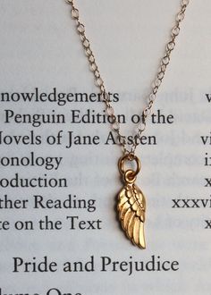 Dainty Angel Wing Gold Charm Necklace by MooseAndNigel on Etsy, $26.00