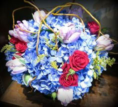 An electric display of color - hydrangea, roses, and tulips