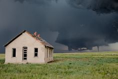 A tornado spawned in the grassland of the Colorado Palmer Divide on June 4, 2015. Zigzagging down desolate country roads to get a closer look, I saw a small structure in the distance. As luck would have it the road came to a sharp turn at the front of this abandoned building. Even with lightning flashing nearby I knew I had to seize the photo opportunity of a lifetime. With adrenaline pumping I climbed atop of my truck to capture this incredible scene.