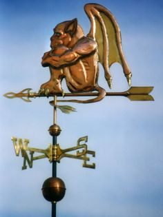Gargoyle Weathervane by West Coast Weather Vanes.  The Gargoyle weathervane is particularly endearing in the small, although the large and extra-large sizes look quite spectacular perched atop a turret or cupola. Some customers have nightlights on their Gargoyle weather vanes so they can be seen against a dark sky when driving up to the house. They are quite a conversation starter!