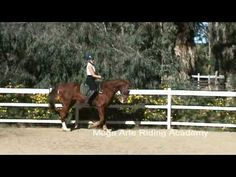 """Trainer Meg Brown,continues Becky's lesson on """"Red"""" with, riding without stirrup serpentine exercises"""