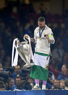 Sergio Ramos of Real Madrid celebrates with The Champions League trophy after the UEFA Champions League Final between Juventus and Real Madrid at National Stadium of Wales on June 3, 2017 in Cardiff, Wales.