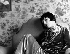 Louise Brooks, we admire her laid back chic style that marked a new era of 20's fashion.  We love her use of accessories to add that feminine nod to some of her boyish inspired fashions.